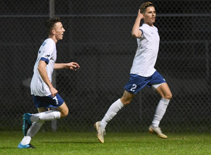 Ian Leighton and Matt Rebel of West Shore celebrate a goal during Thursday's Cape Coast Conference championship game.