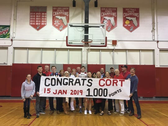 Satellite's Cort Green passed 1,000 points on Jan. 15. He (holding ball ) is pictured with friends and family. Courtesy of Tammy Green.