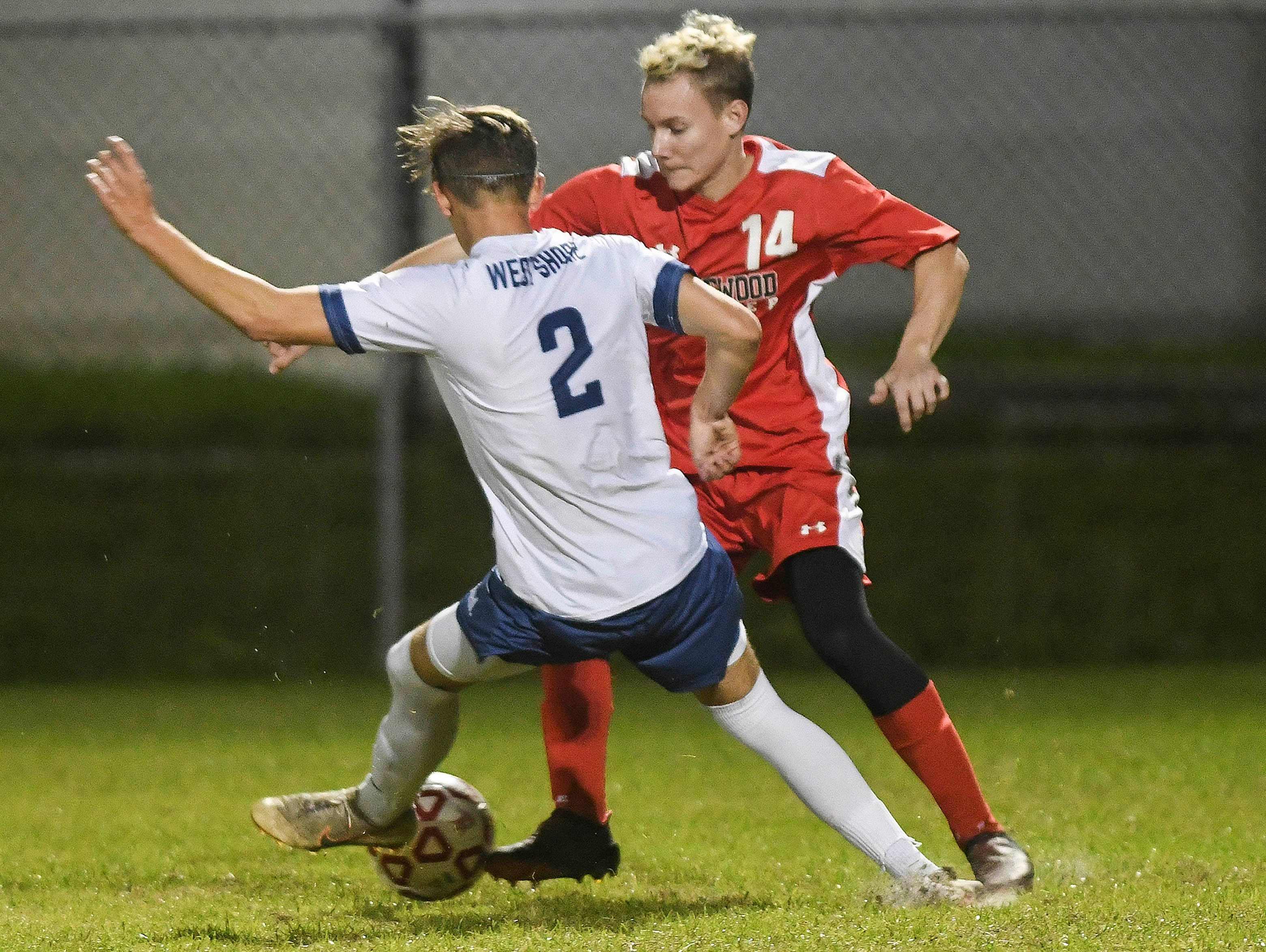Ian Leighton of West Shore tries to maneuver around Adam Ussery of Edgewood during Thursday's Cape Coast Conference championship game.