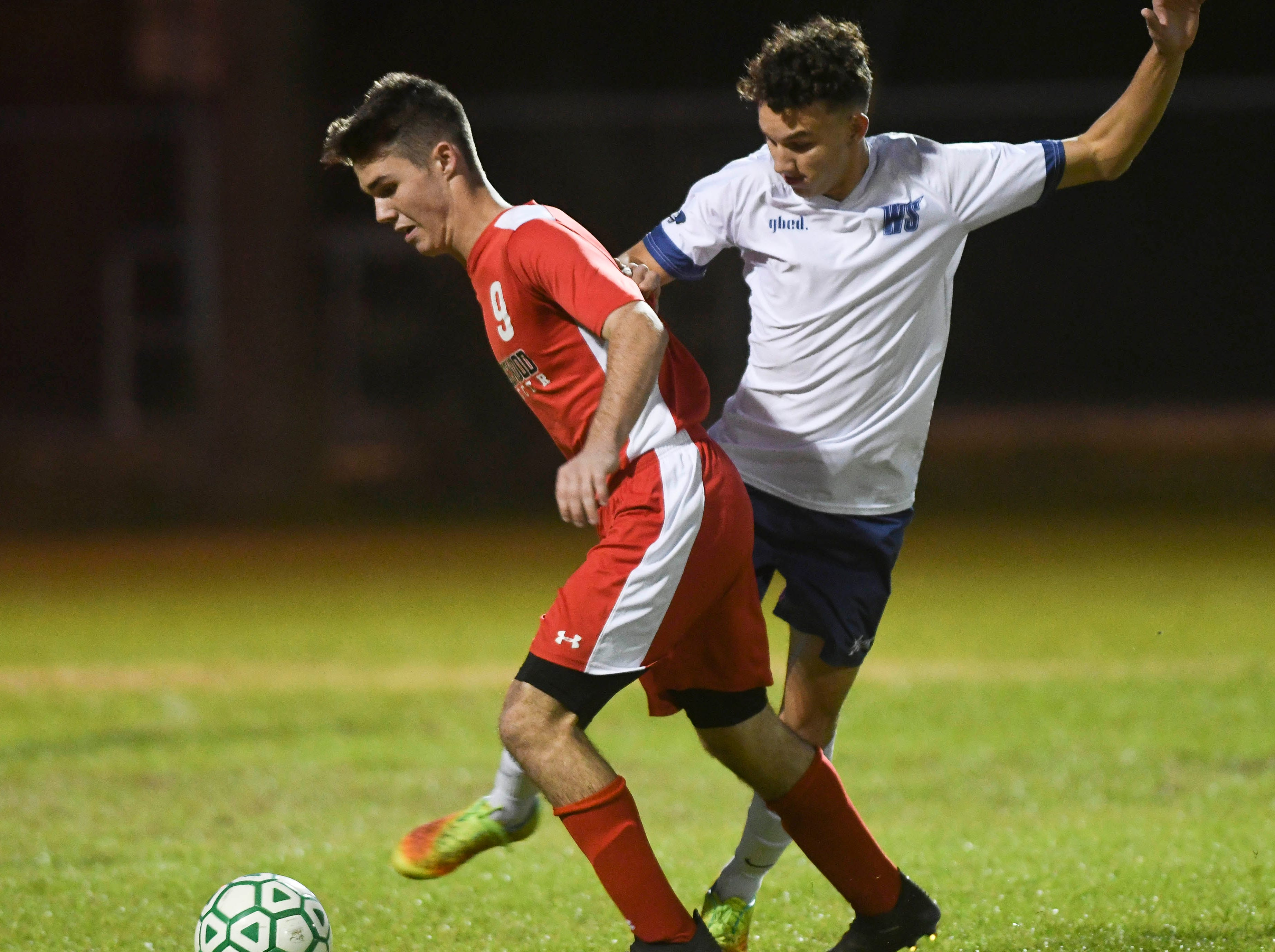 Edgewood's Grant Paparella and Cameron Yeutter of West Shore battle for the ball during Thursday's Cape Coast Conference championship game.
