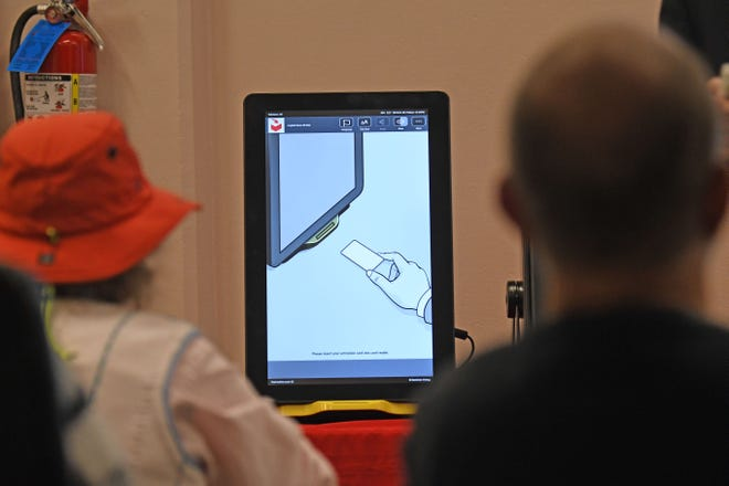 Members of the Crawford County Board of Elections watch a presentation on potential new voting machines on Friday.