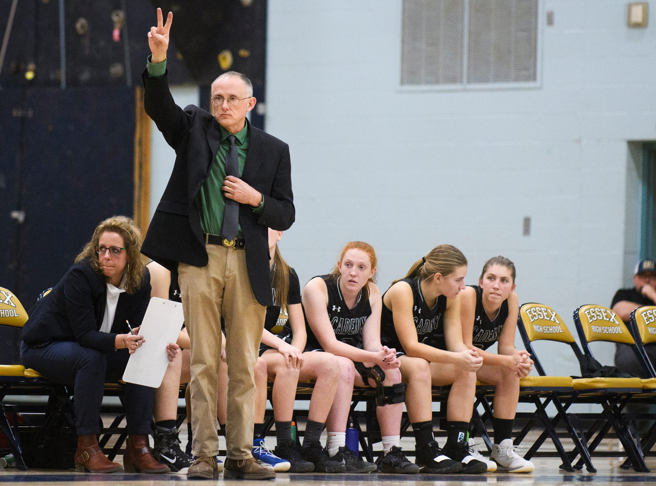 St. Johnsbury head coach Jack Driscoll calls a play during the girls basketball game between the St. Johnsbury Hilltoppers and the Essex Hornets at Essex High School on Thursday night January 17, 2019 in Essex.