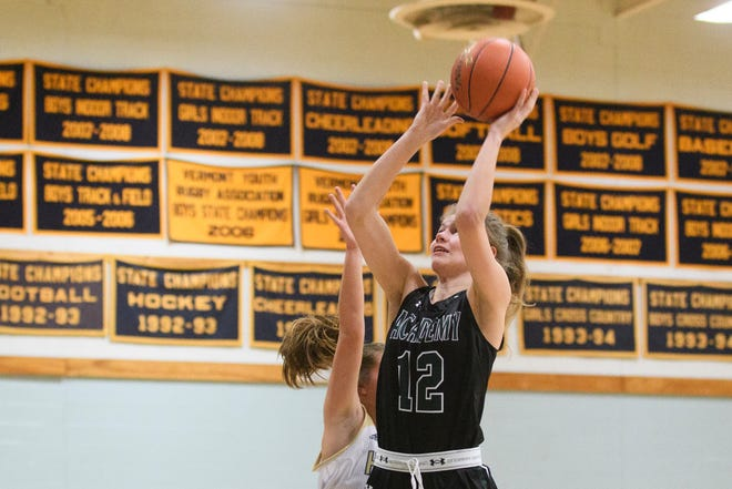 St. Johnsbury's Lara Rohkohl (12) leaps to take a shot during the girls basketball game between the St. Johnsbury Hilltoppers and the Essex Hornets at Essex High School on Thursday night January 17, 2019 in Essex.