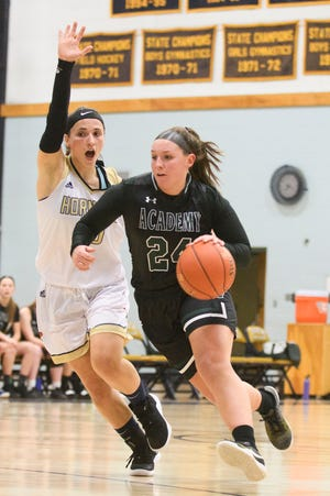 St. Johnsbury's Josie Choiniere (24) drives to the hoop past Essex's Adrienne Notes (10) during the girls basketball game between the St. Johnsbury Hilltoppers and the Essex Hornets at Essex High School on Thursday night January 17, 2019 in Essex.