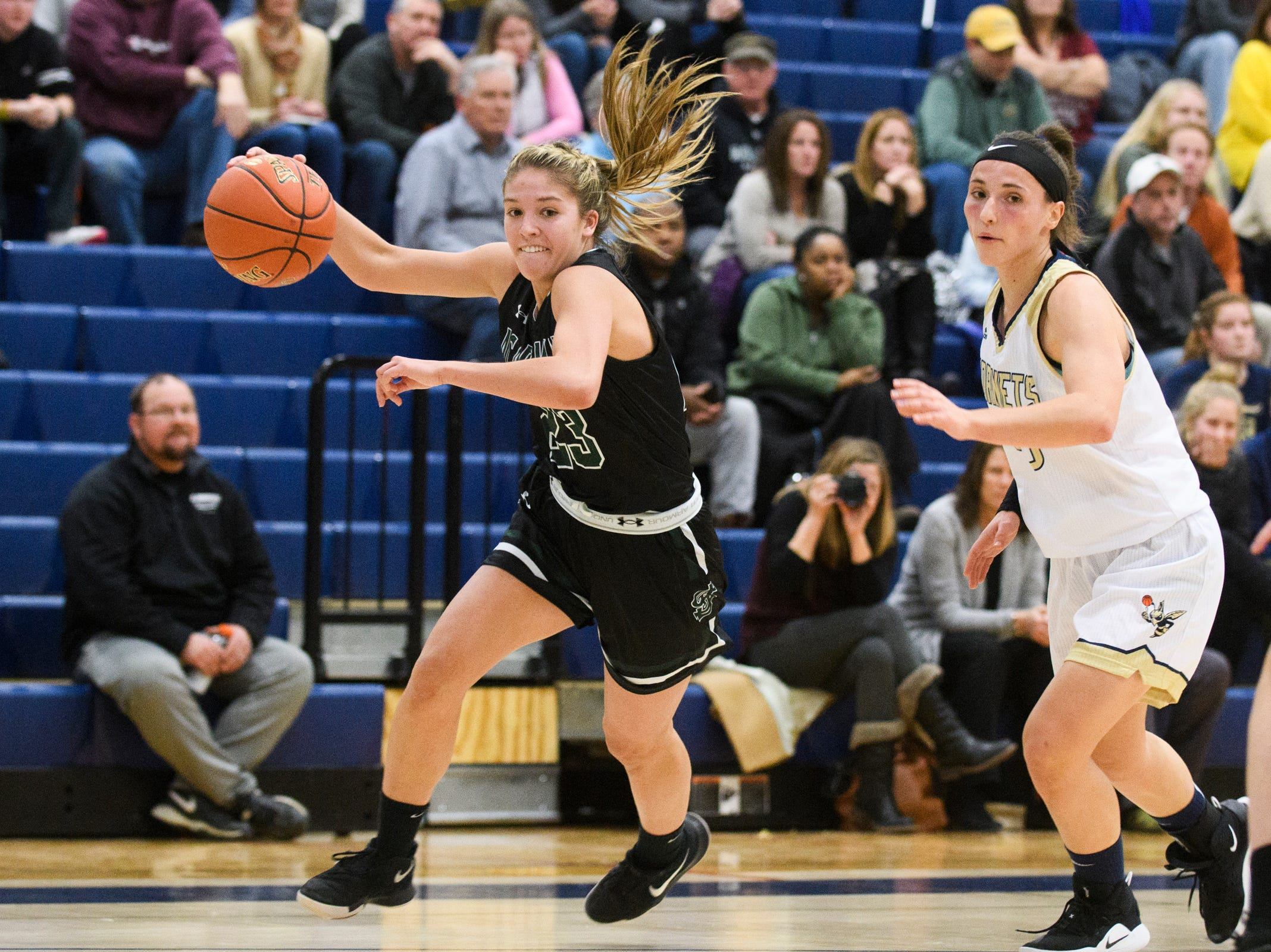St. Johnsbury's Neva Bostic (23) drives to the hoop past Essex's Adrienne Noyes (10) during the girls basketball game between the St. Johnsbury Hilltoppers and the Essex Hornets at Essex High School on Thursday night January 17, 2019 in Essex.