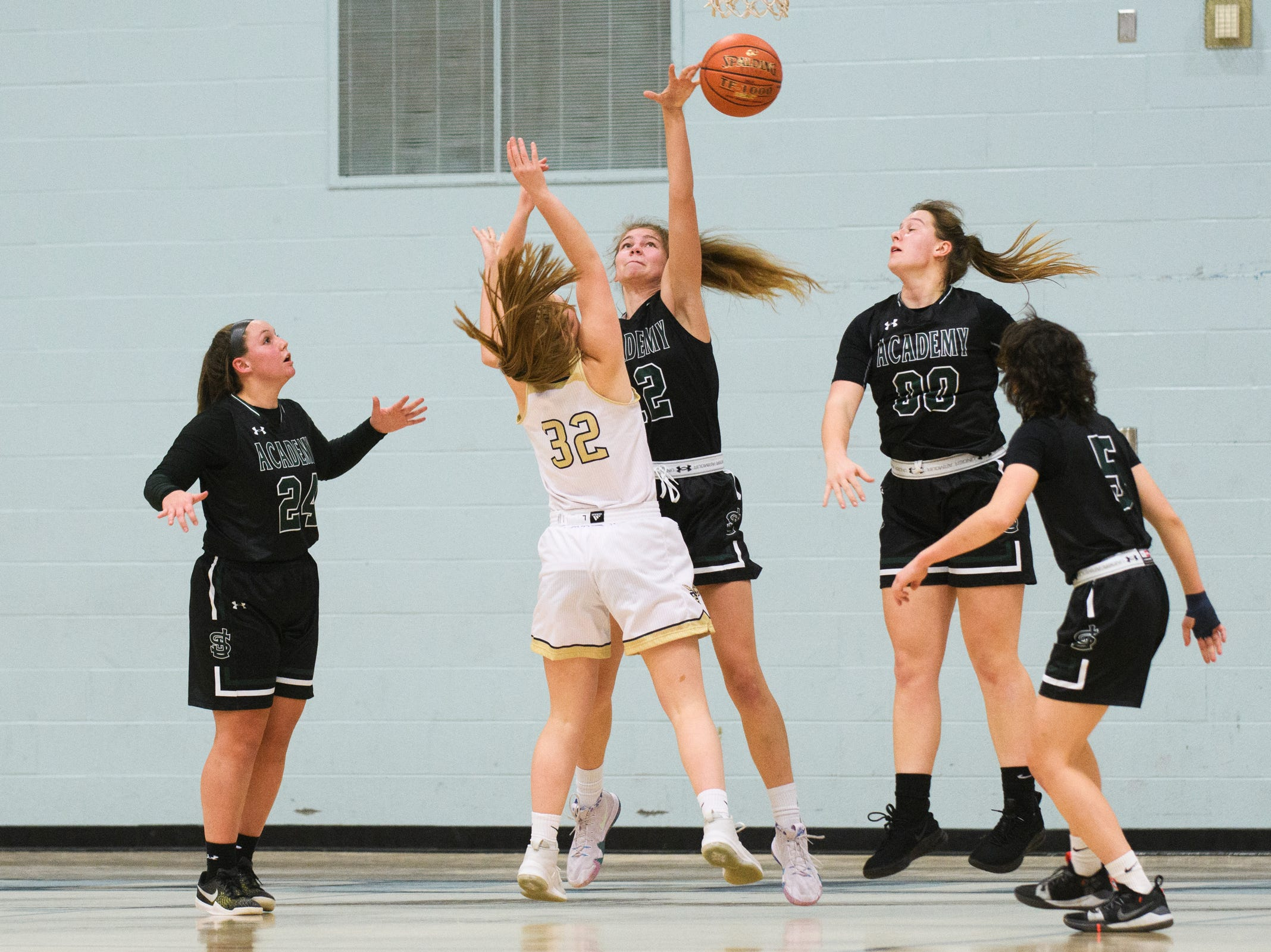 St. Johnsbury's Lara Rohkohl (12) blocks the shot by Essex's Sarah Coulter (32) during the girls basketball game between the St. Johnsbury Hilltoppers and the Essex Hornets at Essex High School on Thursday night January 17, 2019 in Essex.