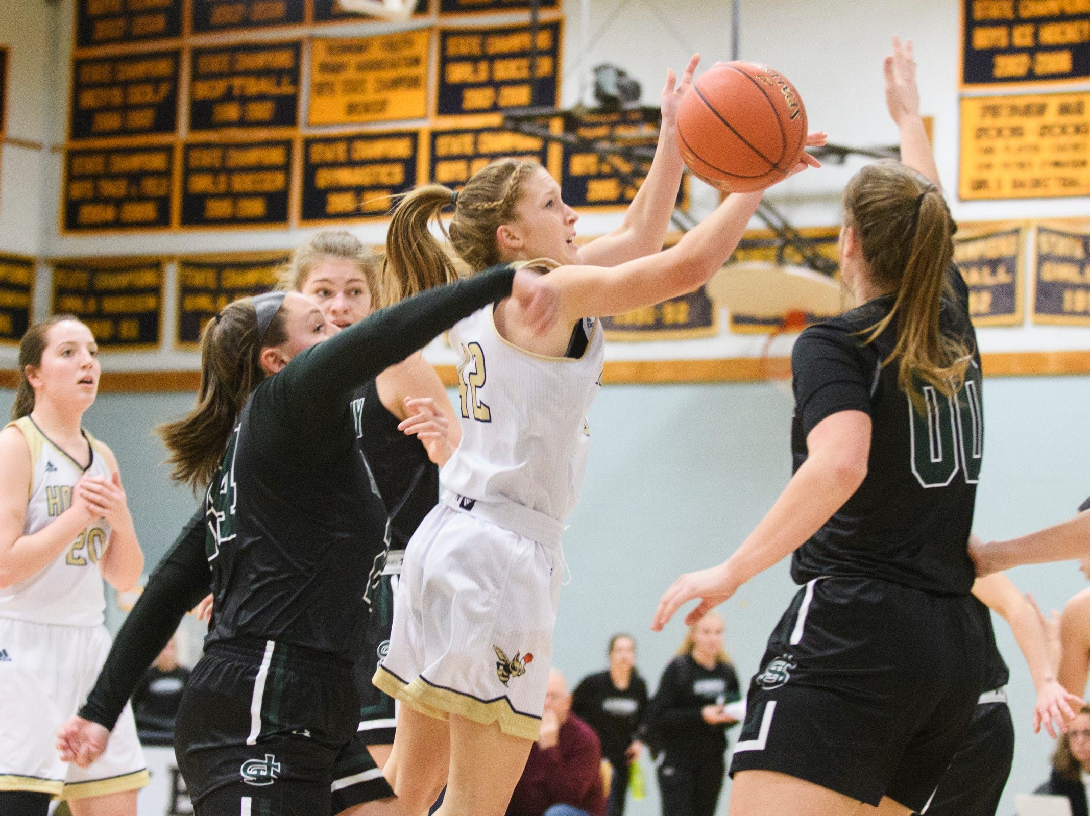 Essex's Anna Sabourin (42) loses control of the ball as she leaps for a lay up during the girls basketball game between the St. Johnsbury Hilltoppers and the Essex Hornets at Essex High School on Thursday night January 17, 2019 in Essex.