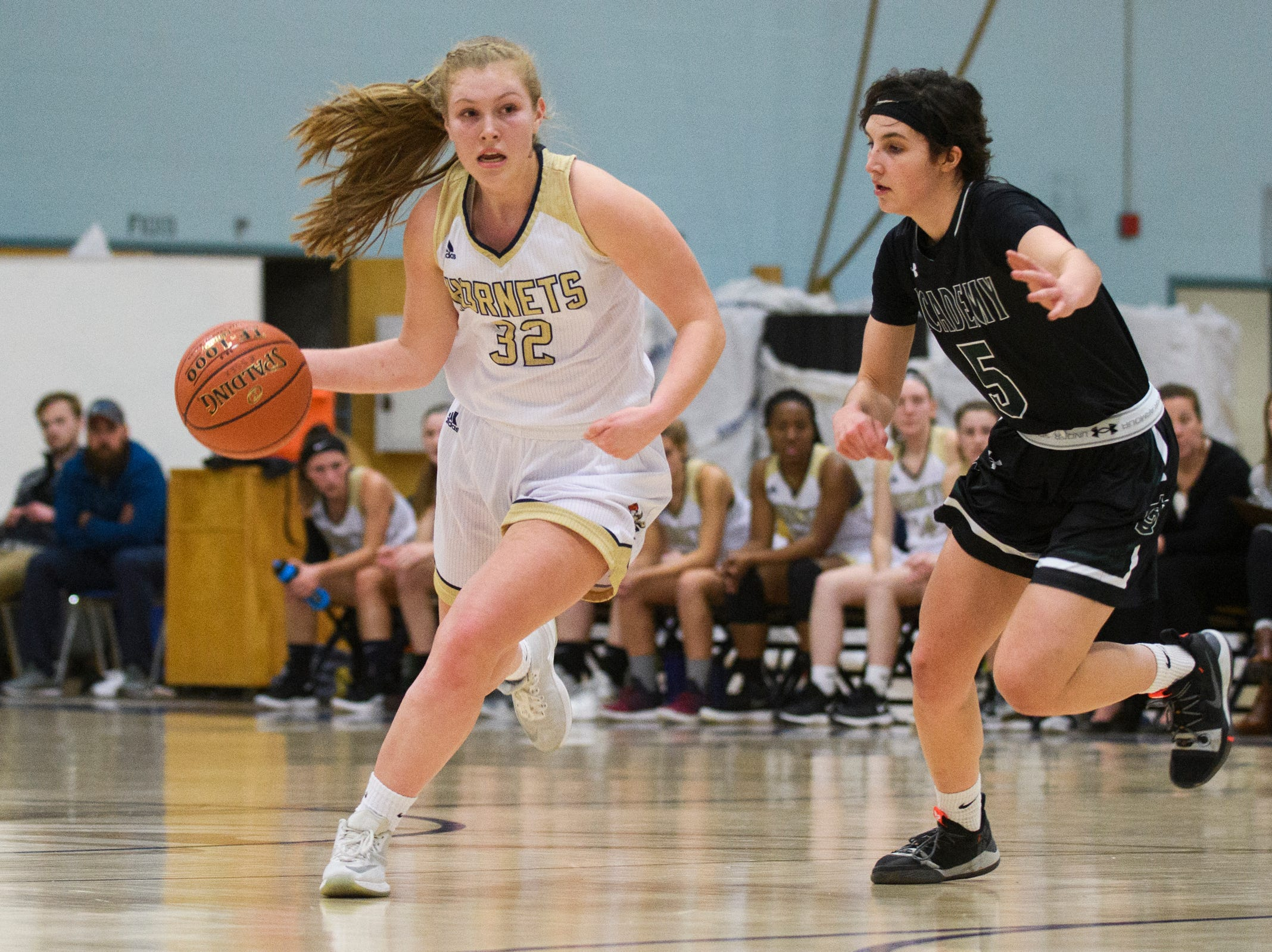 Essex's Sarah Coulter (32) drives to the hoop past St. Johnsbury's Sadie Stetson (5) during the girls basketball game between the St. Johnsbury Hilltoppers and the Essex Hornets at Essex High School on Thursday night January 17, 2019 in Essex.