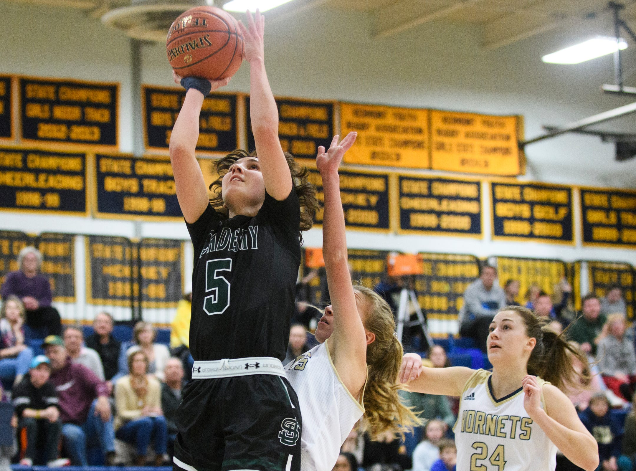 St. Johnsbury's Sadie Stetson (5) leaps for a lay up during the girls basketball game between the St. Johnsbury Hilltoppers and the Essex Hornets at Essex High School on Thursday night January 17, 2019 in Essex.