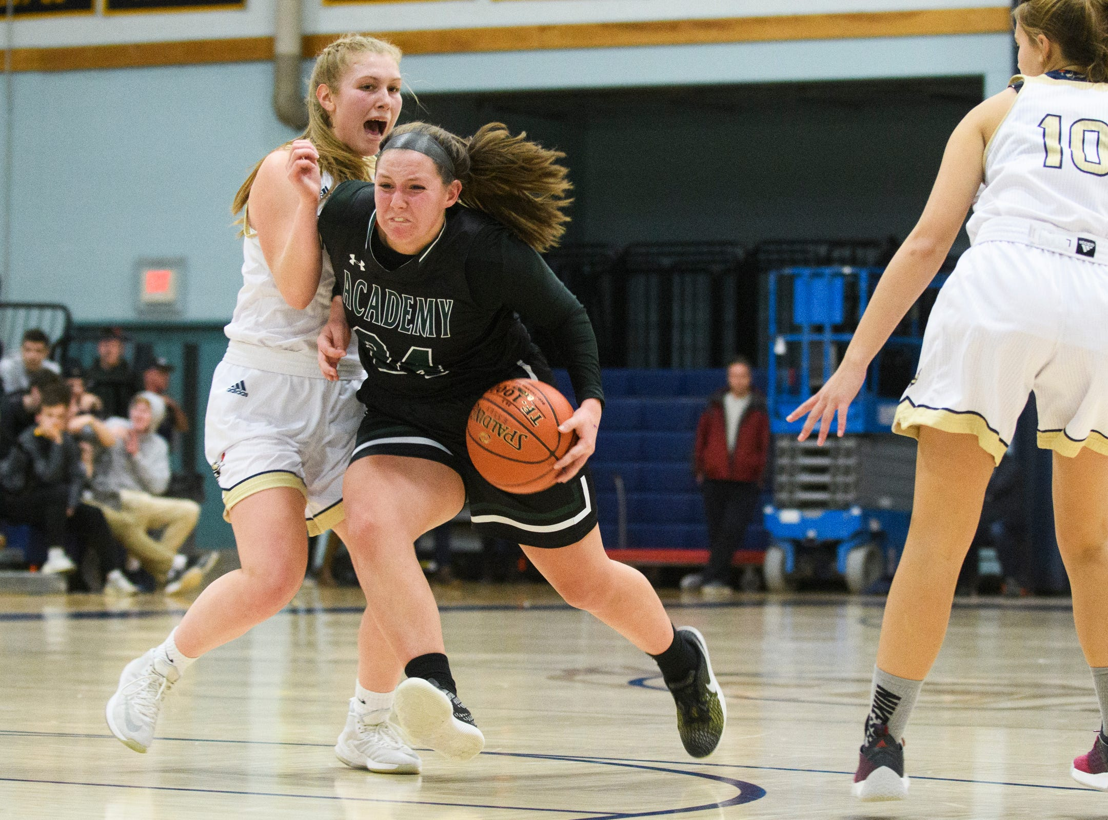St. Johnsbury's Josie Choiniere (34) drives to the hoop during the girls basketball game between the St. Johnsbury Hilltoppers and the Essex Hornets at Essex High School on Thursday night January 17, 2019 in Essex.