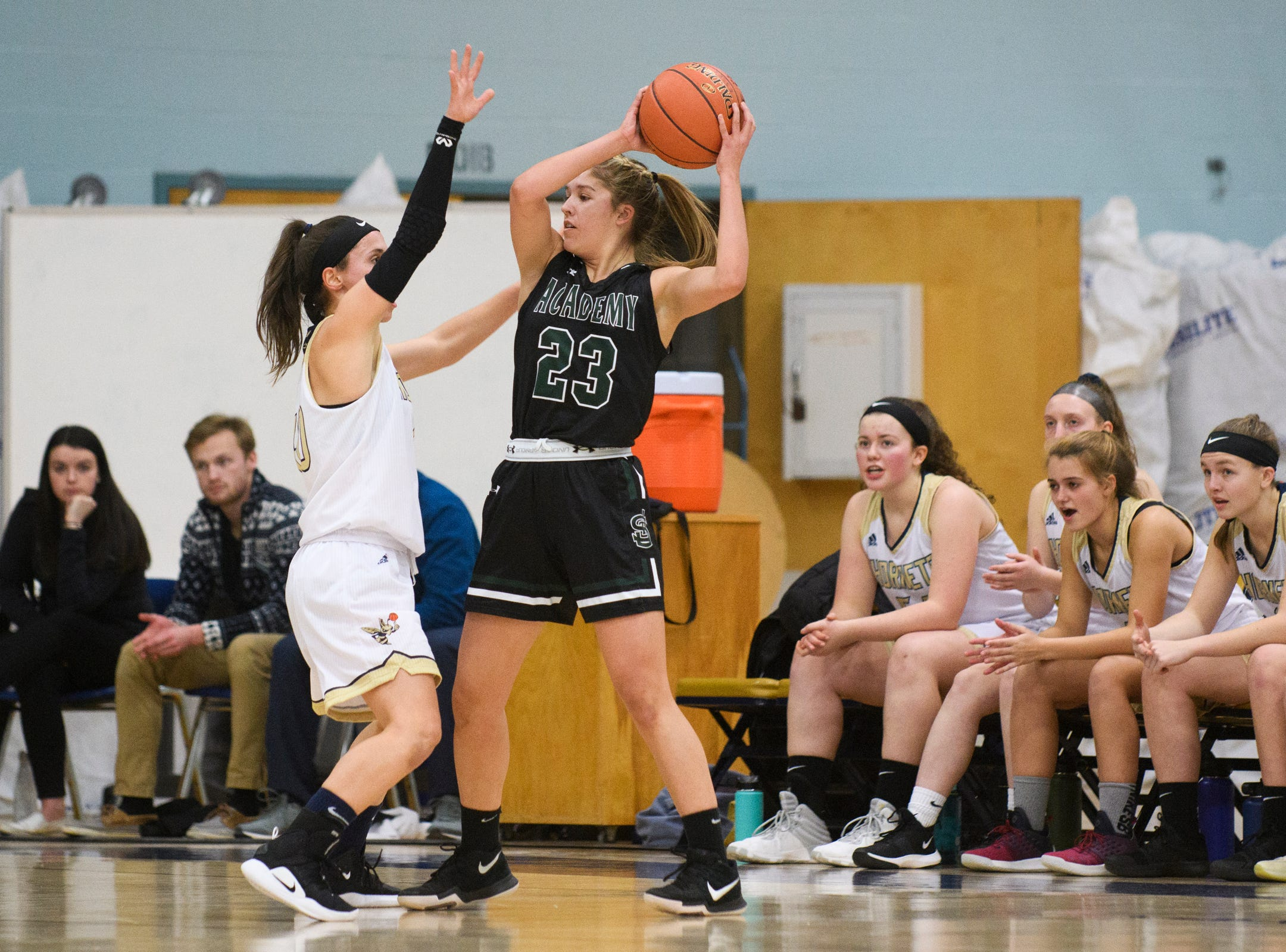 St. Johnsbury's Neva Bostic (23) looks to pass the ball as she is guarded by Essex's Adrienne Notes (10) during the girls basketball game between the St. Johnsbury Hilltoppers and the Essex Hornets at Essex High School on Thursday night January 17, 2019 in Essex.