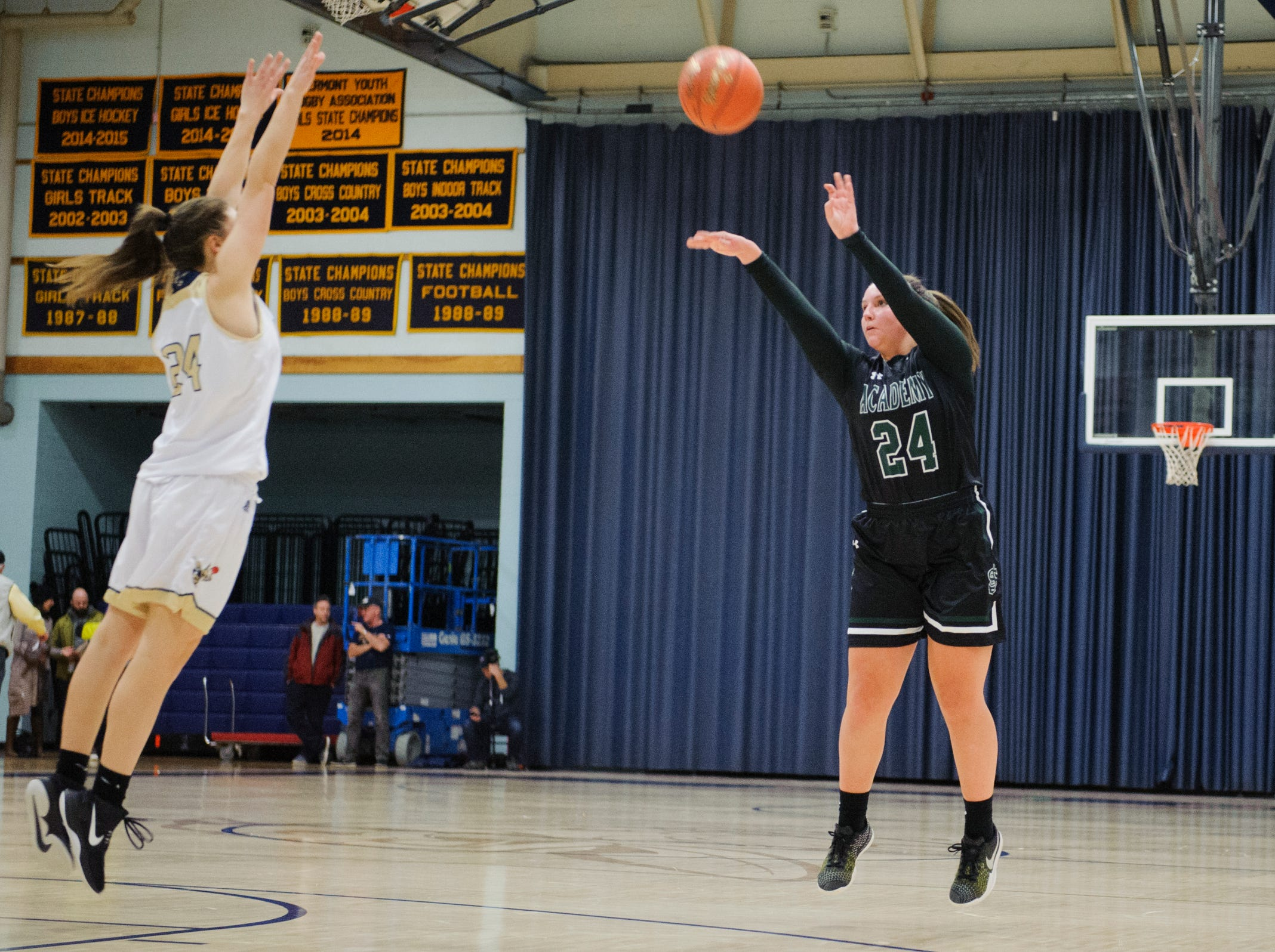 St. Johnsbury's Josie Choiniere (24) shoots a three pointer during the girls basketball game between the St. Johnsbury Hilltoppers and the Essex Hornets at Essex High School on Thursday night January 17, 2019 in Essex.