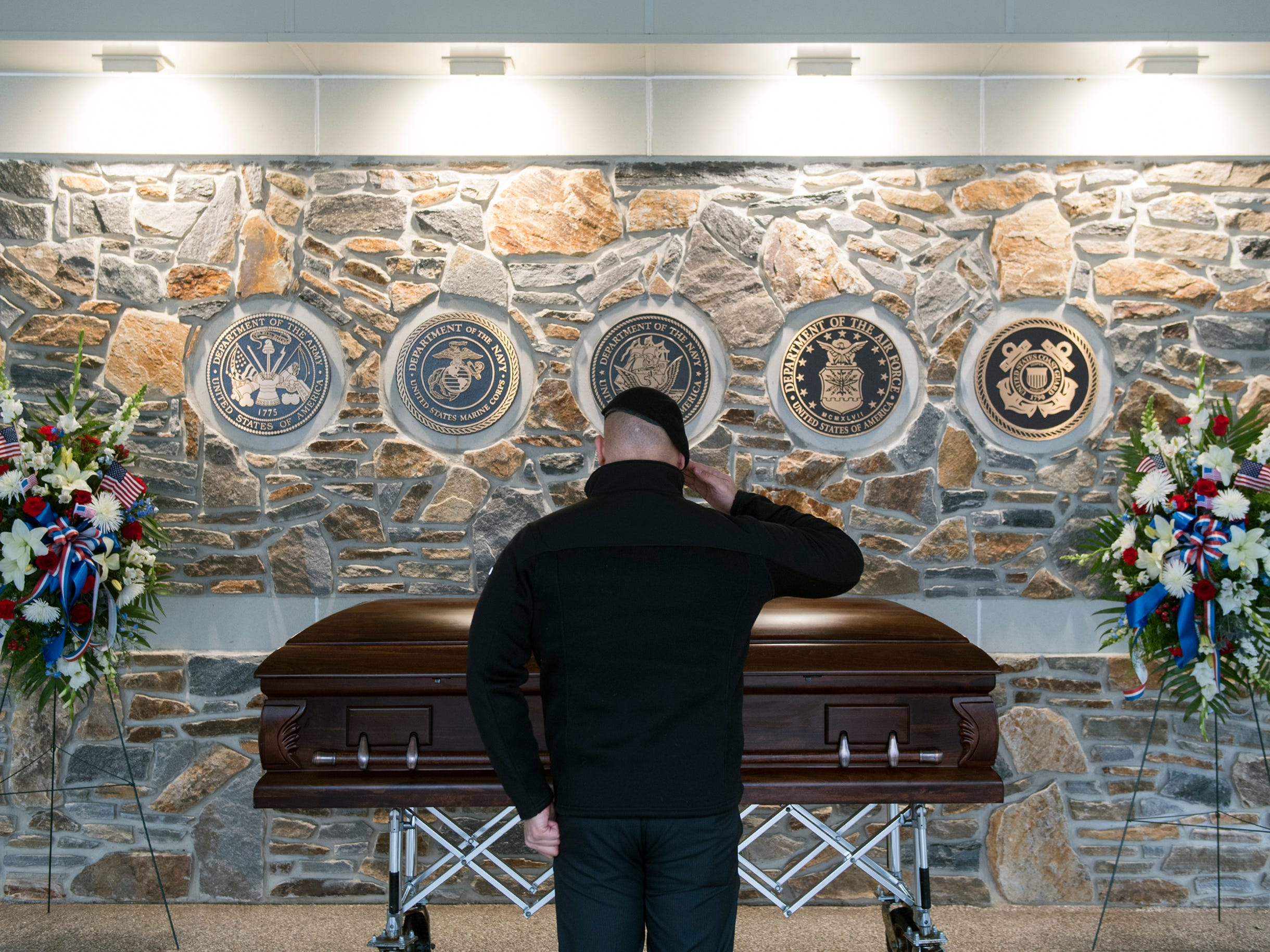Former Army Captain Rogers Ramirez salutes Vietnam veteran Peter Turnpu as several hundreds gather for a funeral Friday, Jan. 18, 2019 in North Hanover, N.J.