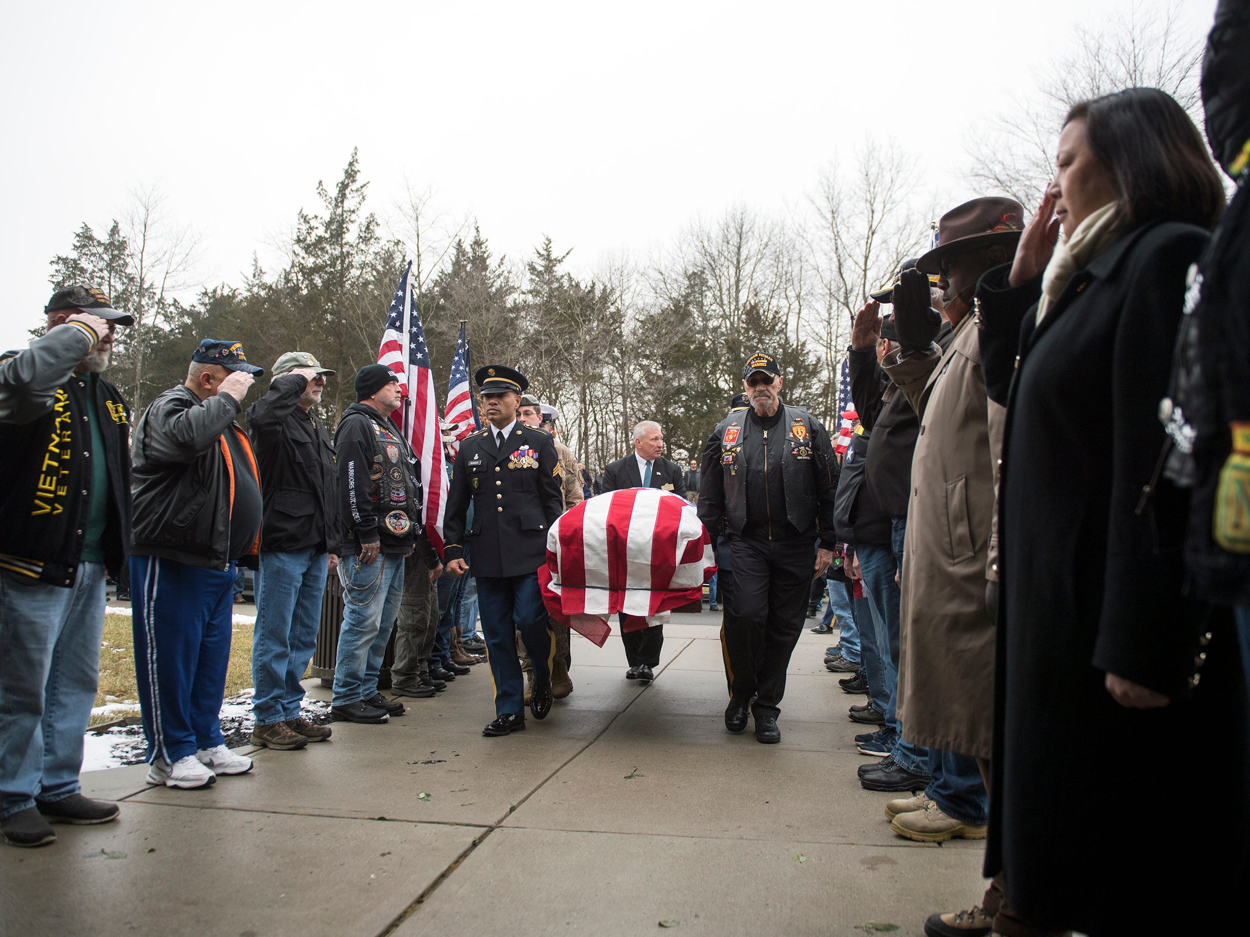 Pallbearers carry the casket of Vietnam veteran Peter Turnpu as several hundreds gather for a funeral Friday, Jan. 18, 2019 in Wrightstown, N.J.