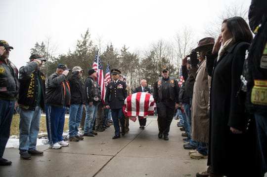Pall bearers carry the casket of Vietnam-era veteran Peter Turnpu as several hundreds gather for a funeral Friday, Jan. 18, 2019 in Wrightstown, N.J.