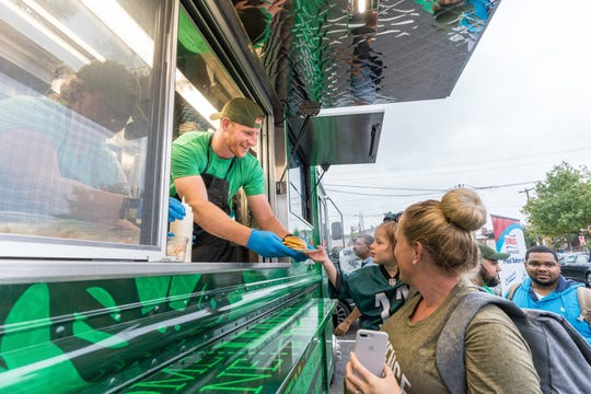 Carson Wentz serves up food-truck fare at Thy Kingdom Crumb's launch in September.