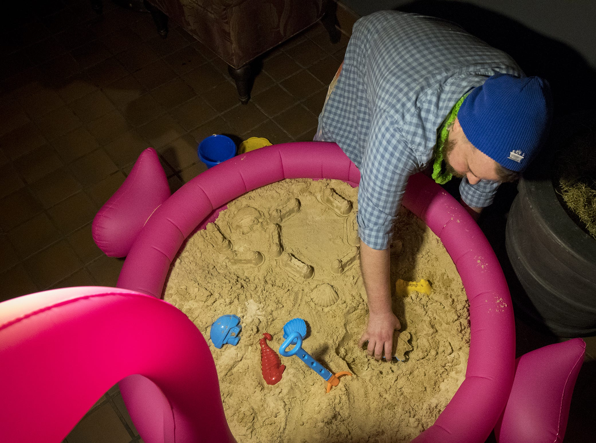 Taft's employee Jake Wedding tests out the sand brought in for Beach Night at Taft's Ale House January 17, 2019 in Cincinnati, Ohio.