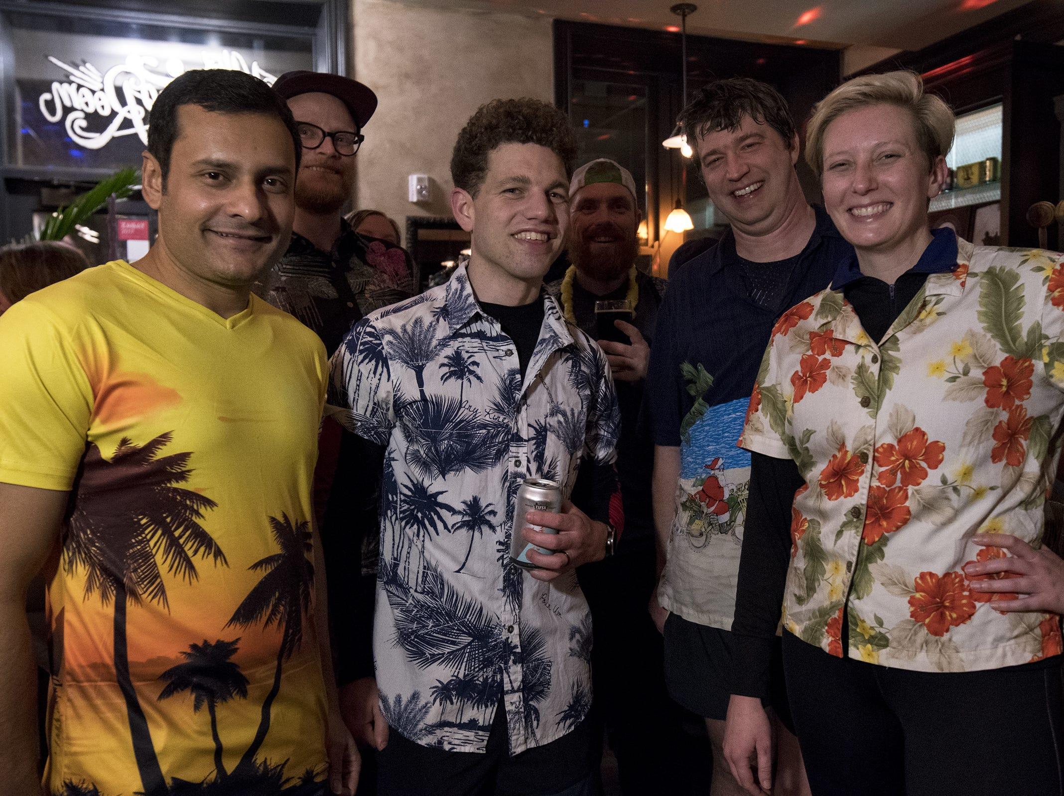 Taft Running Club members Shaahid Noor, Stephen Abt, Paul Staudigel, Mitch Morrison and Lindsey Cencula don Hawaiian shirts for Beach Night at Taft's Ale House January 17, 2019 in Cincinnati, Ohio.