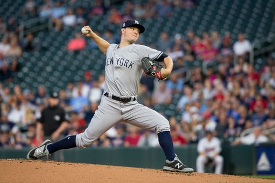 Sep 11, 2018; Minneapolis, MN, USA; New York Yankees starting pitcher Sonny Gray (55) pitches in the first inning against Minnesota Twins at Target Field. Mandatory Credit: Brad Rempel-USA TODAY Sports