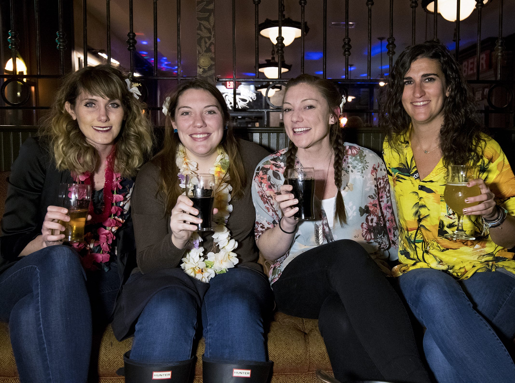 Alexis Roark, Sarah Pendleton, Erin Dunn and Jessica Shvarts trade coats and gloves for leis and Hawaiian shirts during Beach Night at Taft's Ale House January 17, 2019 in Cincinnati, Ohio.