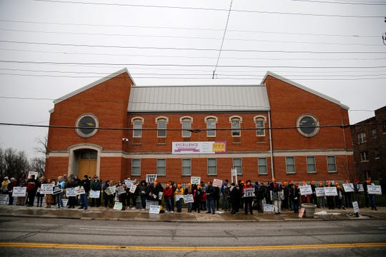 Demonstrators gather to pray and protest during a local gathering in support of the national March for Life event in front of the Planned Parenthood office in the Mt. Auburn neighborhood of Cincinnati on Friday, Jan. 18, 2019.