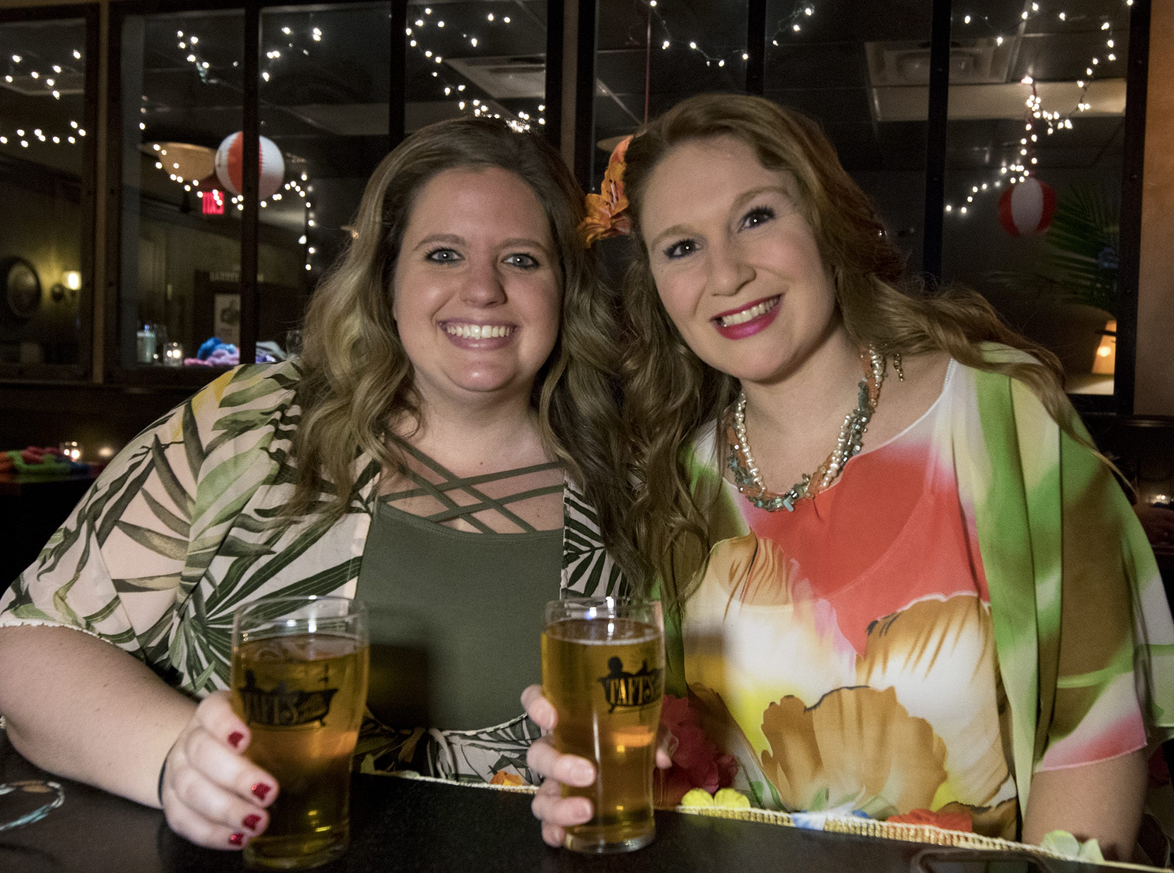 Heather Roush and Emily Phillips grab a pint during Beach Night at Taft's Ale House January 17, 2019 in Cincinnati, Ohio.