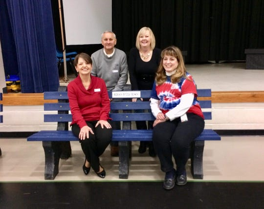 Pictured in back, Aiden Kramer's grandparents John Kramer and Marilyn Kramer and pictured front, Kim Gilbert and Veronica Stamper of Burlington Elementary gather around a Buddy Bench made and purchased in honor of Aiden.