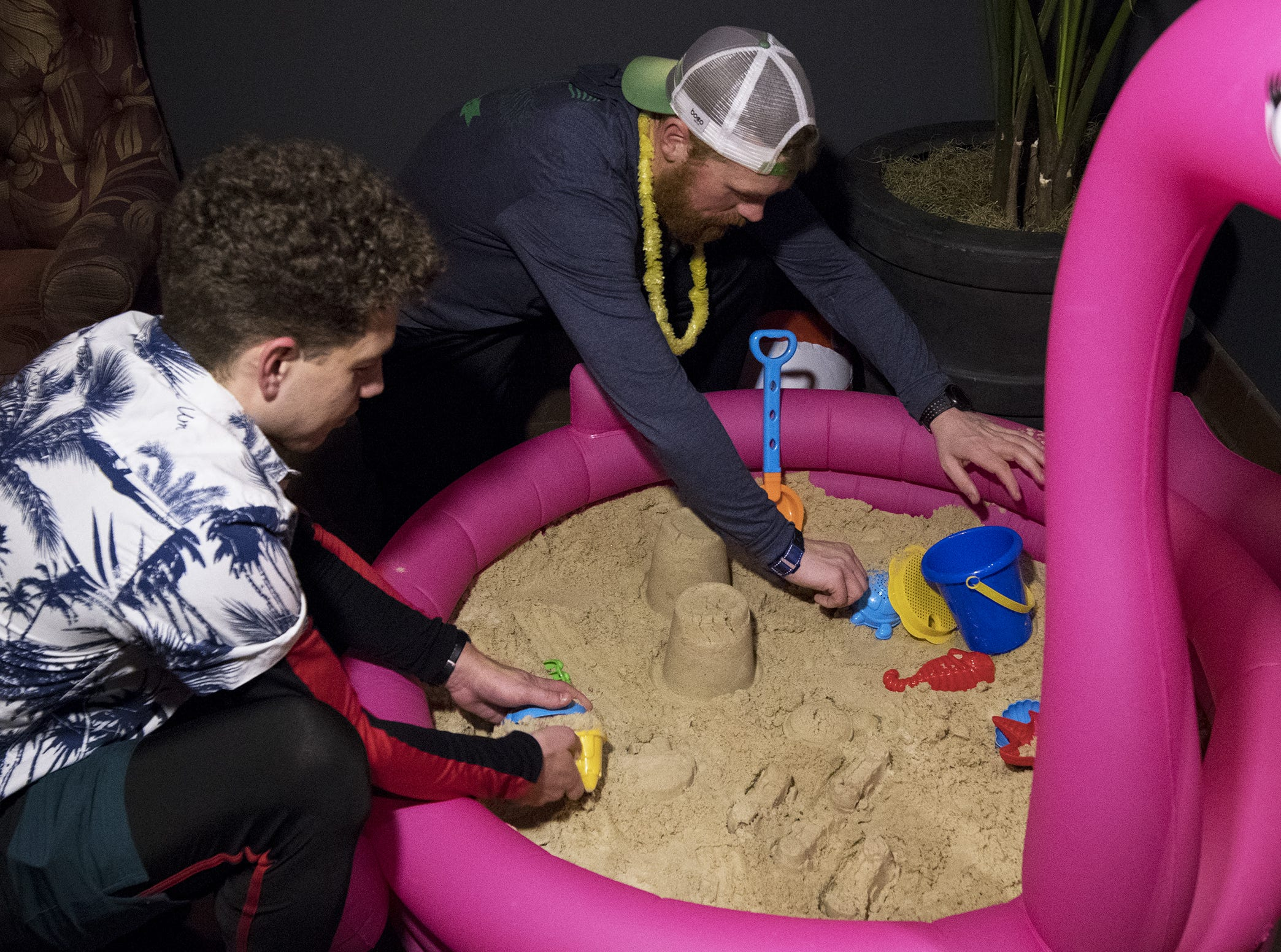 Stephen Abt and Chris Lorenz build sand castles in the 600 lbs of sand brought in for Beach Night at Taft's Ale House January 17, 2019 in Cincinnati, Ohio.