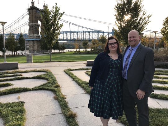 Married IRS employees Becky Ayers Culver and Justin Culver, seen at Smale Riverfront Park in Cincinnati, are among the 800,000 federal workers going without a paycheck during the government shutdown.