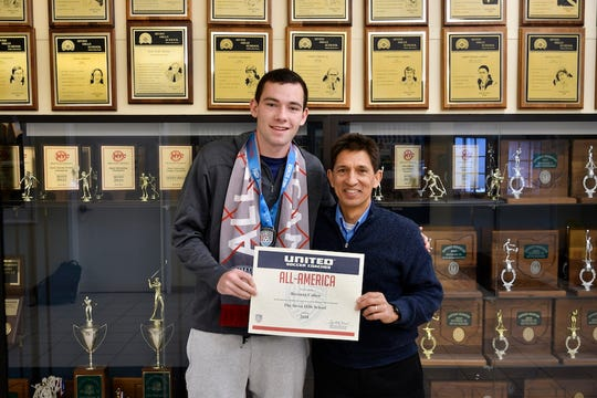 Brennan Callow joins his head coach at Nick Francis with his All-America certificate at Seven Hills School.