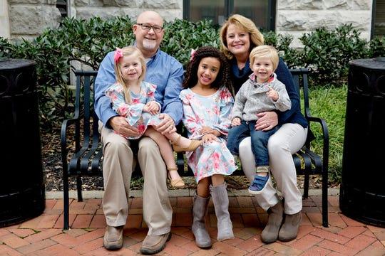 Betty Burchett, seated right, with her husband, Robert, and their three grandchildren.