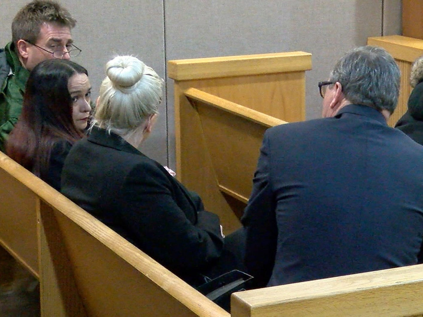 Raquel Garajau's mother Ruth (left) speaks with her attorney Robert Honecker in the row behind Trupal Patel's mother Rita in State Superior Court courtroom in Freehold Friday, January 18, 2019.   Garajau received a 33 year prison term for felony murder and other offenses related to the death of marijuana dealer Trupal Patel.