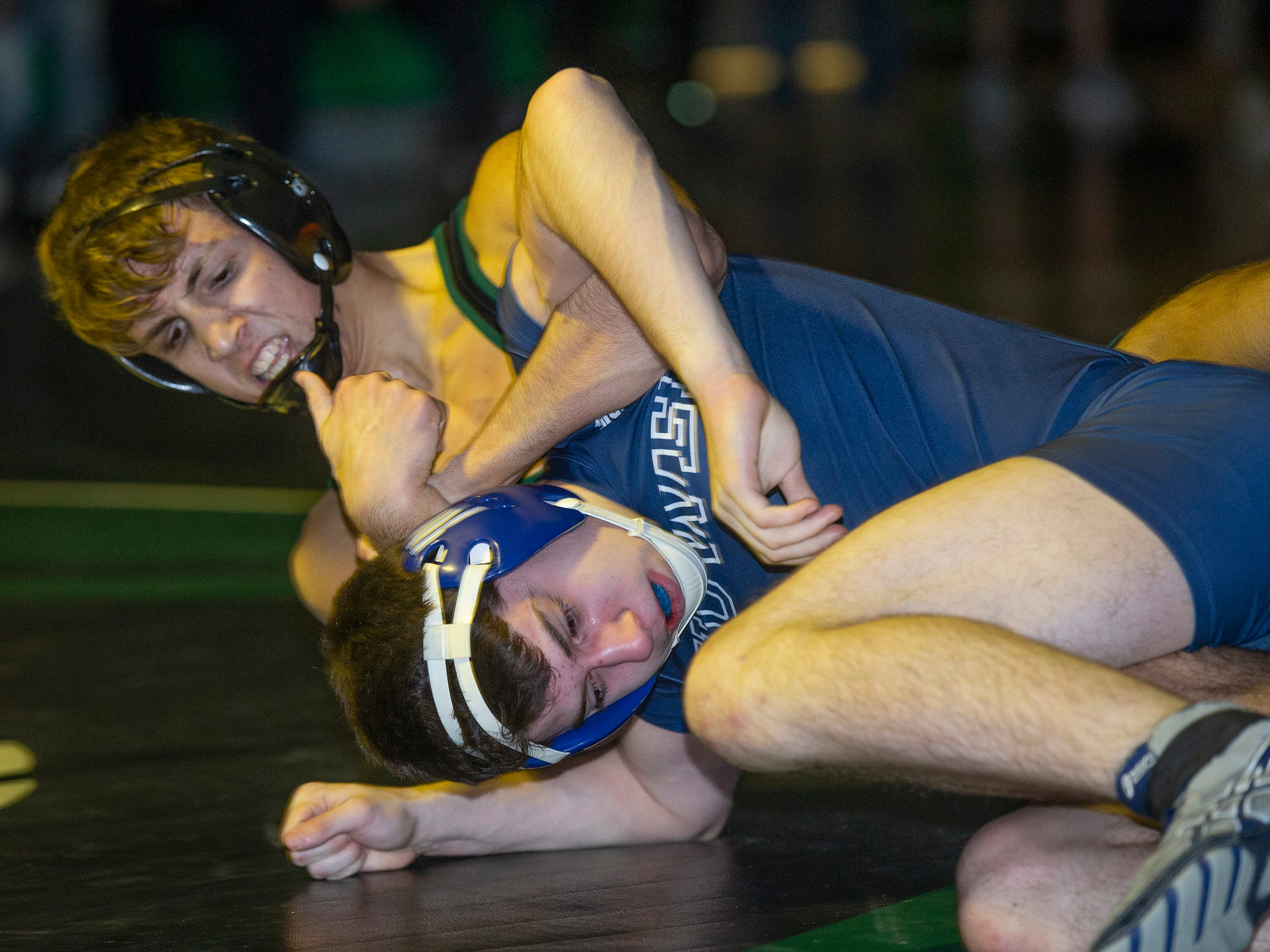 South Plainfield's David Loniewski works for a pin against Howelll's James McGee in their 126 lbs. bout. Howell Wrestling edges out South Plainfield in South Plainfield NJ on January 17, 2019.