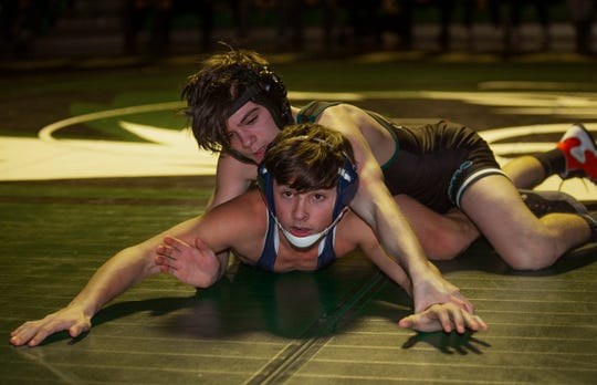 South Plainfield's Jacob DelVecchio  defeats Kyle Tase in their 113 lbs. bout. Howell Wrestling edges out South Plainfield in South Plainfield NJ on January 17, 2019.