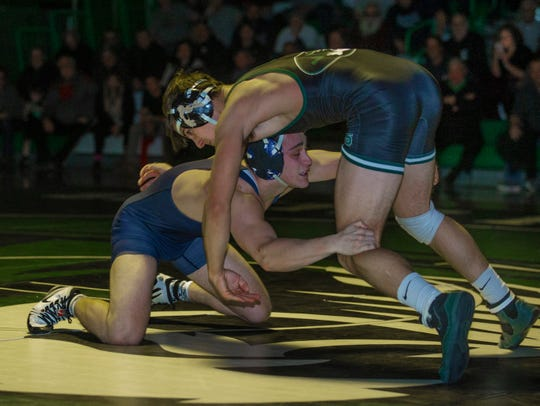 Howell's Paul Jacob defeats South Plainfield's Xavier Kelly in their 152 lbs. bout by a pin. Howell Wrestling edges out South Plainfield in South Plainfield NJ on January 17, 2019.