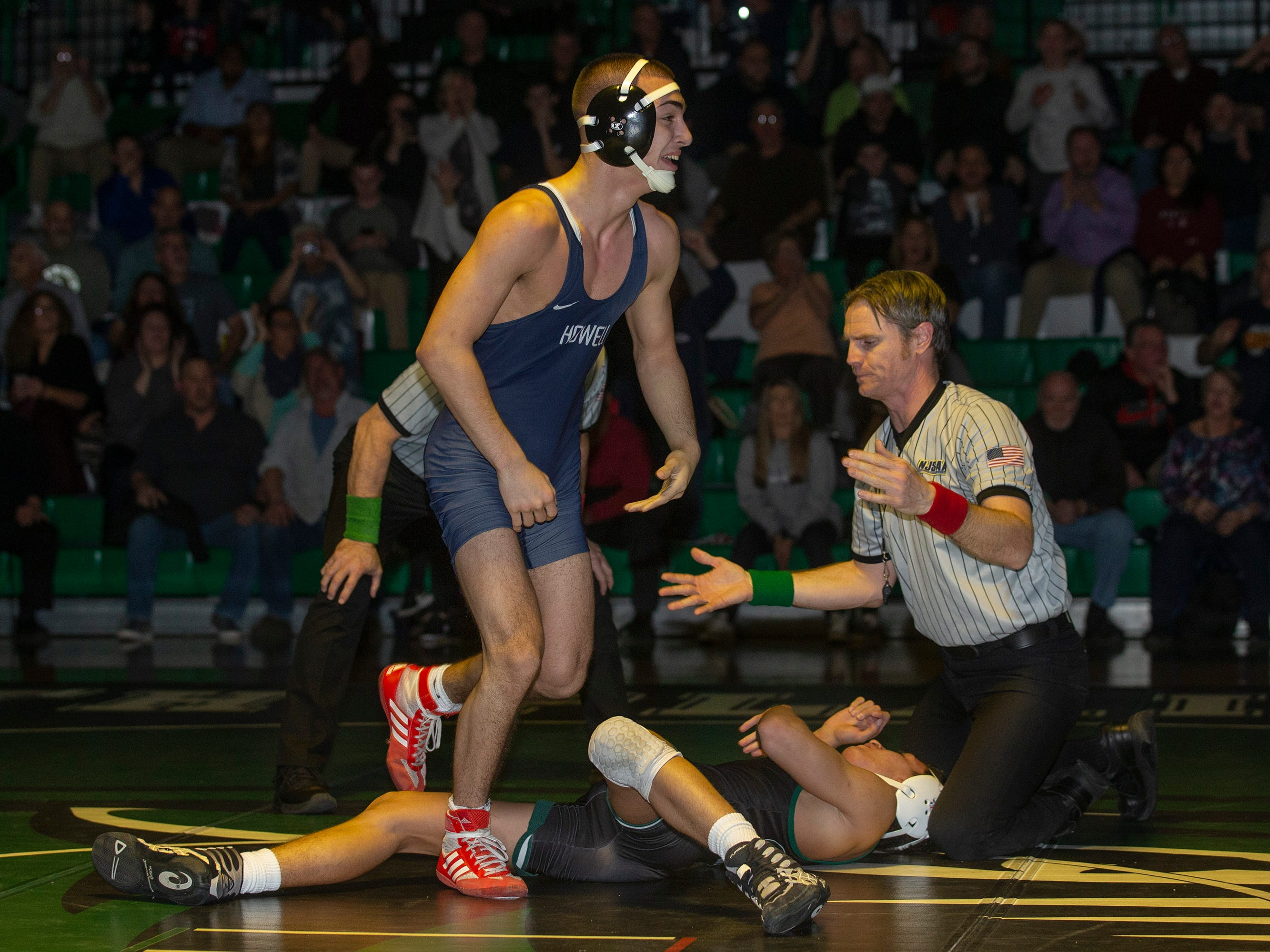 Howell's Nieko Malone pulls off an overtime win against South Plainfield's Thomas Fierro in their 132 lbs. bout. Howell Wrestling edges out South Plainfield in South Plainfield NJ on January 17, 2019.
