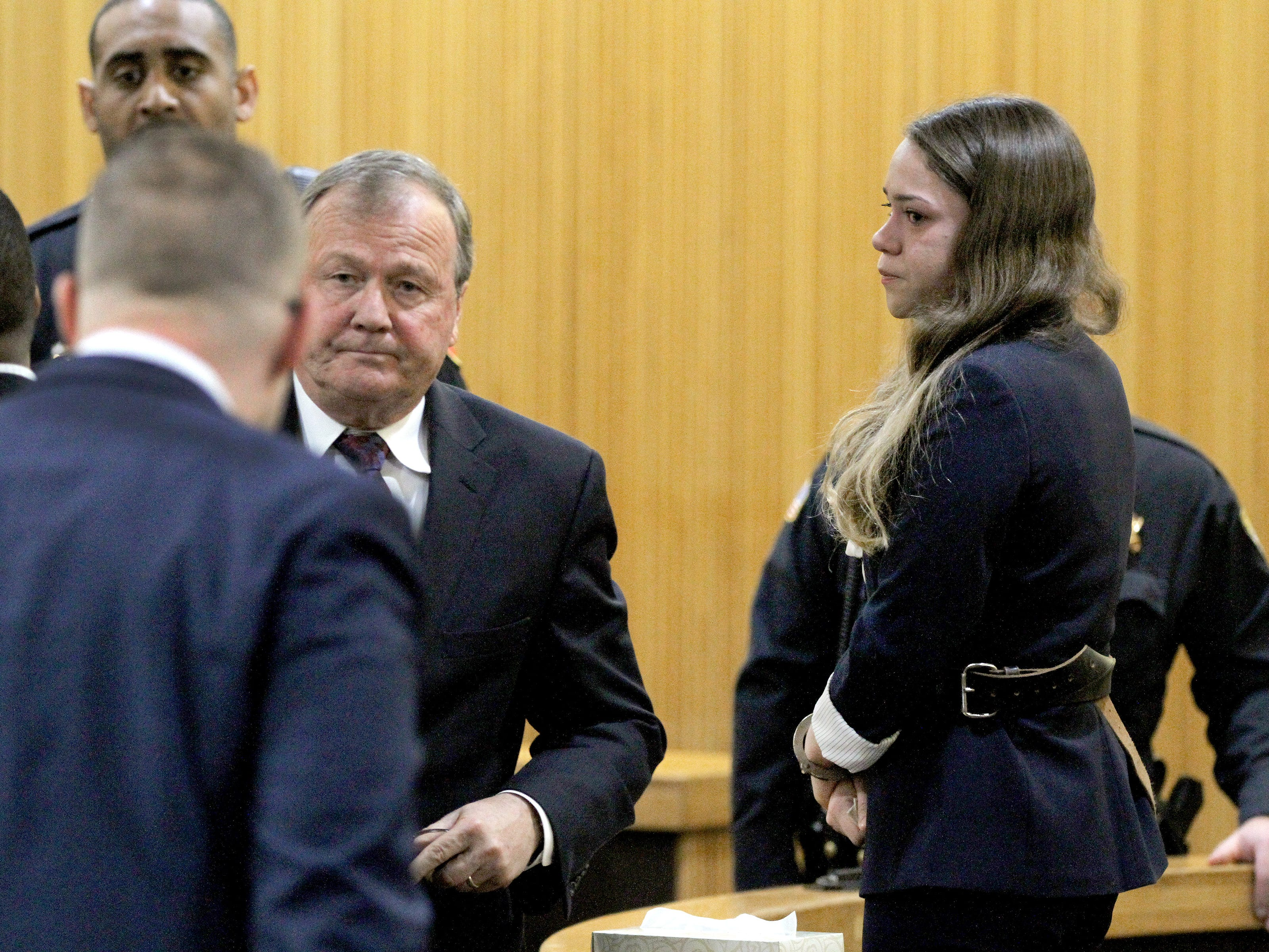 Brookdale Community College honors student Raquel Garajau is shown with her attorney Robert Honecker in State Superior Court courtroom in Freehold Friday, January 18, 2019 after receiving a 33 year prison term for felony murder and other offenses related to the death of marijuana dealer Trupal Patel.