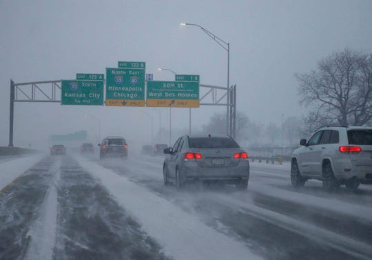 Cars travel along Interstate 80 in West Des Moines during heavy snowfall on Friday, Jan. 18, 2019.
