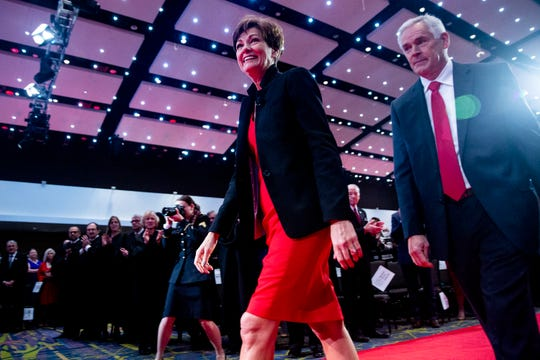 Gov. Kim Reynolds and her husband Kevin Reynolds make their way on to the stage for the Governor's Inauguration on Friday, Jan. 18, 2019, in Des Moines.