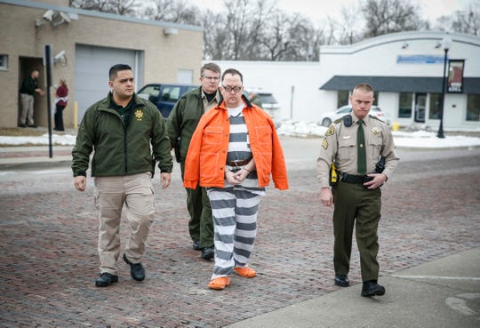 Dallas County sheriff's deputies lead Marc Ray to the courthouse for sentencing in the starvation death of Sabrina Ray on Friday, Jan. 18, 2019, at the Dallas County Courthouse in Adel.