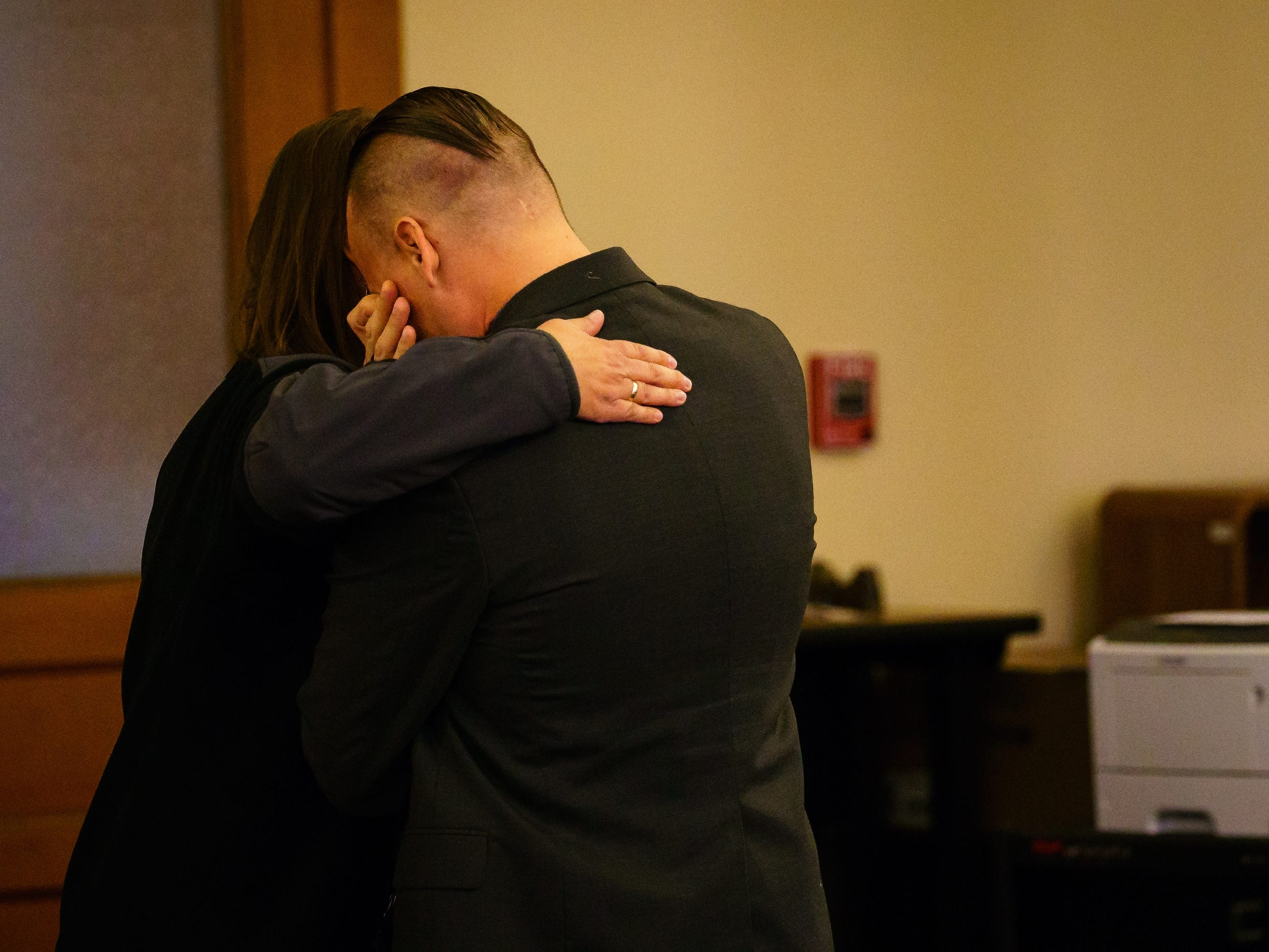 Troy Griffin is consoled after a Dallas County jury found him not guilty in a criminal marital rape case against him at the Dallas County Courthouse on Thursday, Oct. 25, 2018, in Adel. Griffin's ex-wife Gina Battani accused him of raping her multiple times after they were married in April of 2016, but a Dallas County jury found him not guilty on all counts.