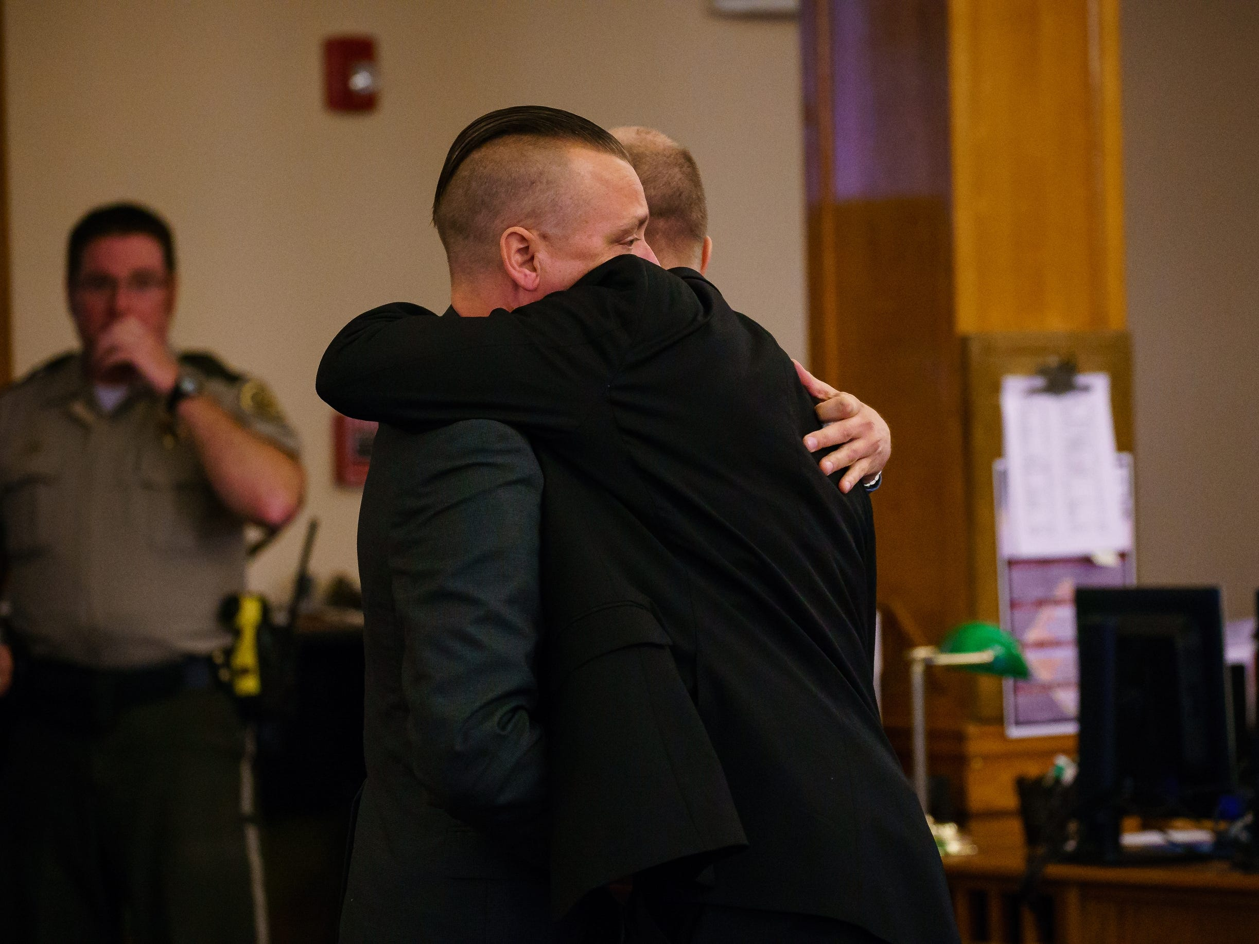 Troy Griffin, left, hugs his defense lawyer, Robert Rehkemper, right, after a Dallas County jury found him not guilty in his marital rape case at the Dallas County Courthouse on Thursday, Oct. 25, 2018, in Adel. Griffin's ex-wife Gina Battani accused him of raping her repeatedly while they were married.
