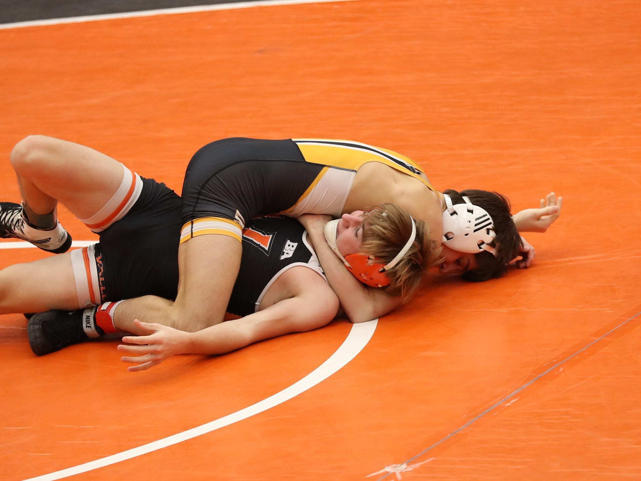 Southeast Polk's Joel Jesuroga pins Valley's Aidan Feldman at Valley High School in West Des Moines on Jan. 17, 2019. The Rams beat the Tigers 53 to 20.