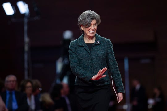 Sen. Joni Ernst finds her seat before Gov. Kim Reynolds' Inauguration ceremony on Friday, Jan. 18, 2019, in Des Moines.