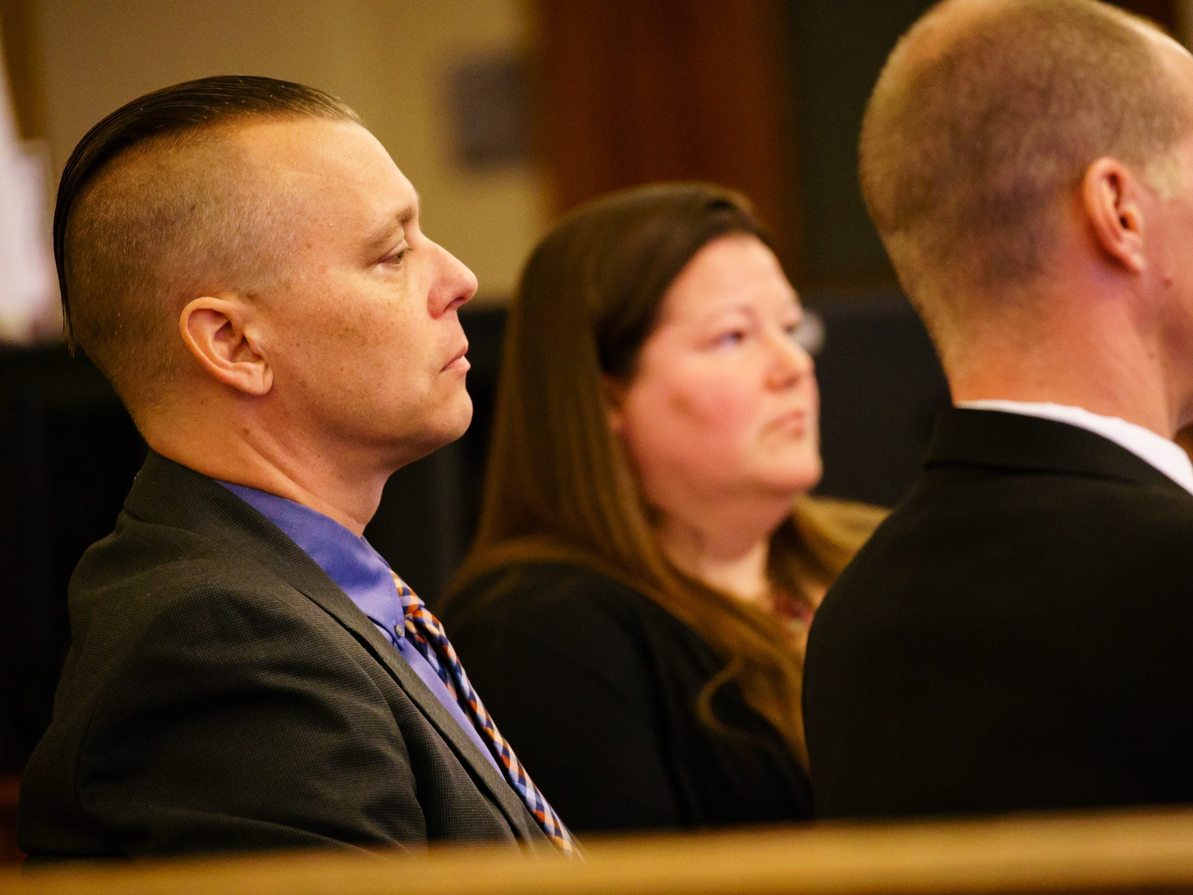 Troy Griffin, left, listens during his trial at the Dallas County Courthouse on Monday, Oct. 22, 2018, in Adel. Griffin's ex-wife Gina Battani accused him of raping her repeatedly during their marriage, but a jury found Griffin not guilty of all charges.