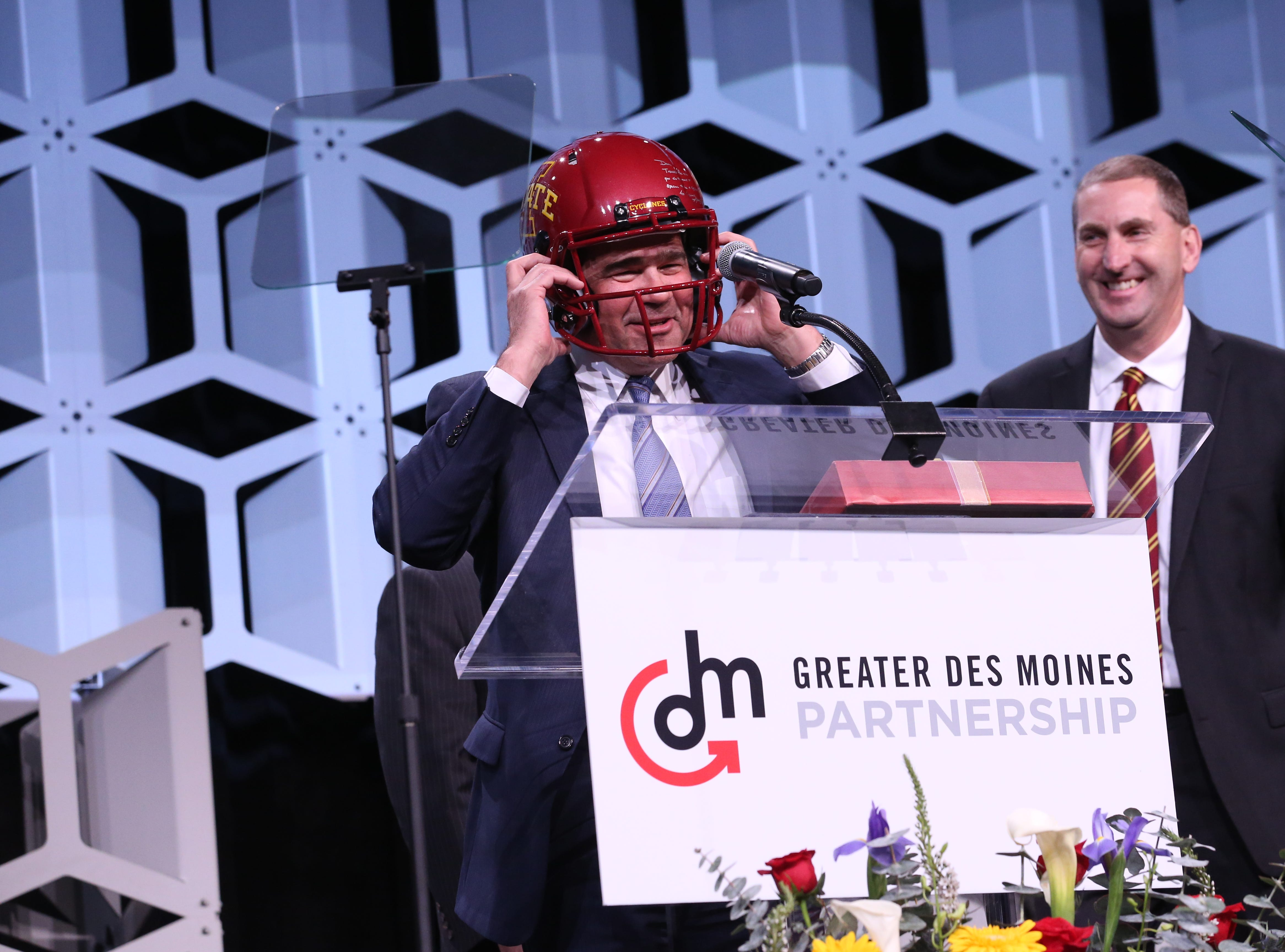 Iowa State University Director of Athletics Jamie Pollard presented 2018 Partnership Board Chair Dan Houston with a gift of an Iowa State football helmet at Partnership's Annual Dinner on January 17, 2019 at the Iowa Events Center.