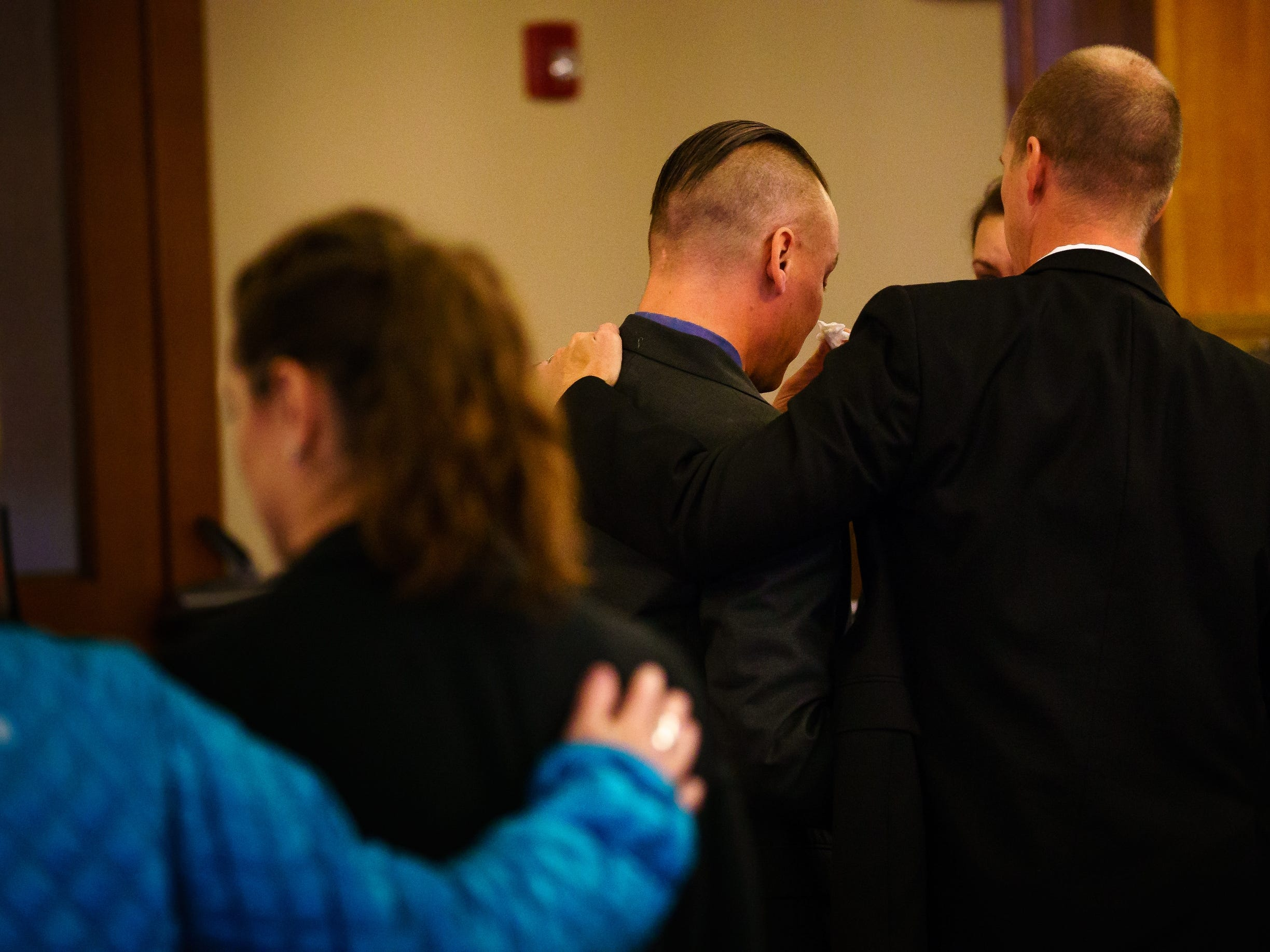 Troy Griffin, center, is congratulated by his defense lawyer, Robert Rehkemper, right, after a jury found Griffin not guilty on all counts in his marital rape trial at the Dallas County Courthouse on Thursday, Oct. 25, 2018, in Adel. Griffin's ex-wife Gina Battani accused him of repeatedly raping her during their marriage.