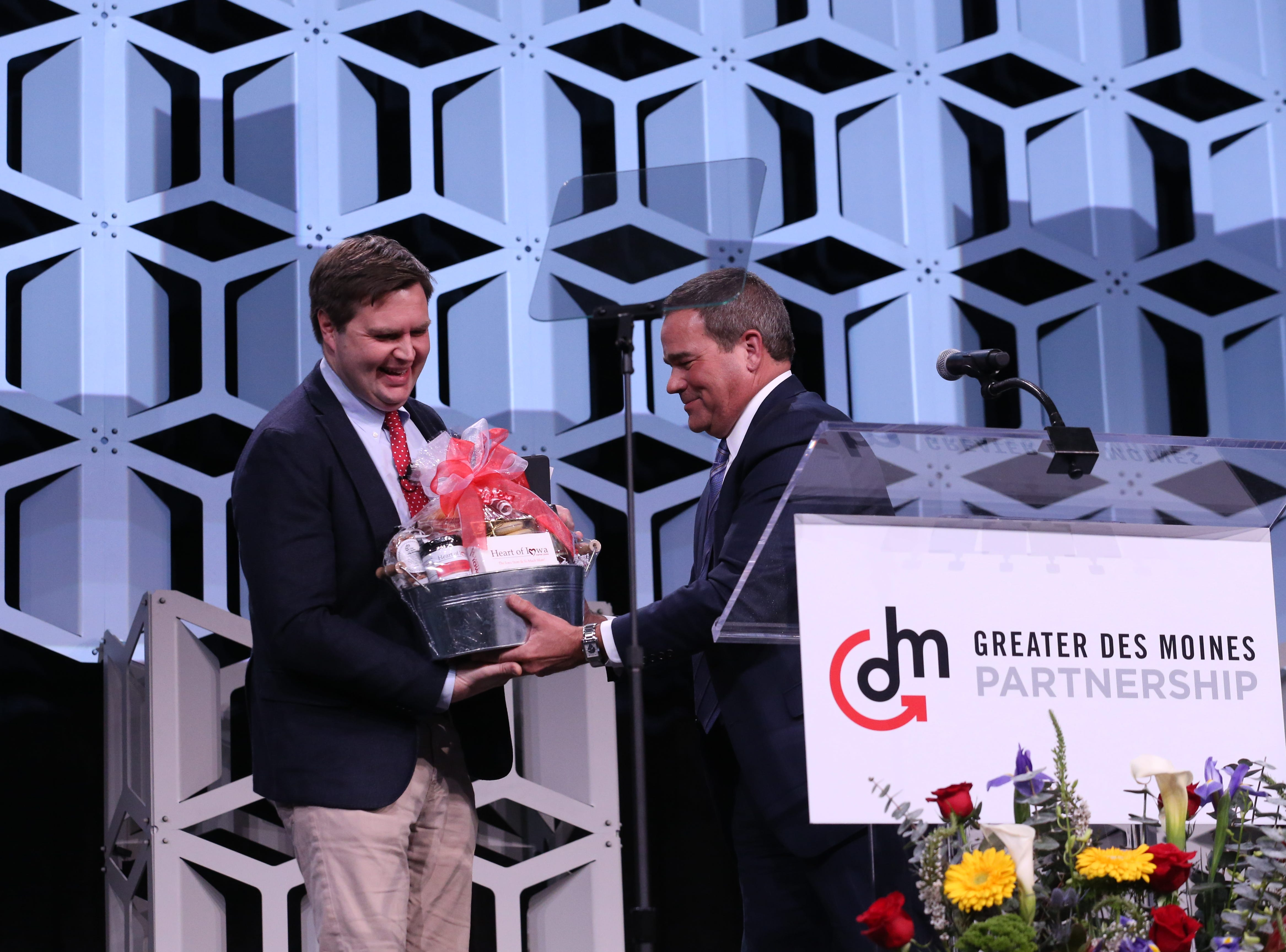 Partnership 2018 Board Chair Dan Houston presents a gift to J.D. Vance. J.D. Vance, the event's keynote speaker.  receives a gift at the Partnership's Annual Dinner on January 17, 2019.