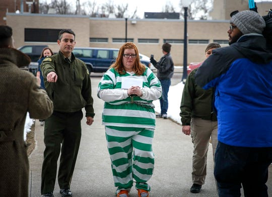 Dallas County sheriff's deputies lead Misty Ray to the courthouse for sentencing in the starvation death of Sabrina Ray on Friday, Jan. 18, 2019, at the Dallas County Courthouse in Adel.