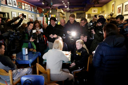 U.S. Kirsten Gillibrand, D-N.Y., with back to camera, sits down for a chat with Jeanette Hopkins, rear, and Chloe McClure, right, at the Pierce Street Coffee Works cafe' in Sioux City, Iowa, Friday, Jan. 18, 2019. Sen. Gillibrand is on a weekend visit to Iowa, after announcing that she is forming an exploratory committee to run for President of the United States in 2020. (AP Photo/Nati Harnik)